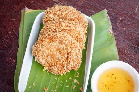 Asian cuisine Fried shrimp cake served with sweet chili sauce photo
