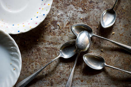 grunge silverware: old spoon still life image with small plate