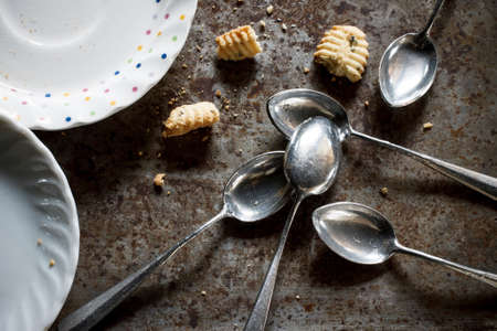 small plate: old spoon still life image with small plate