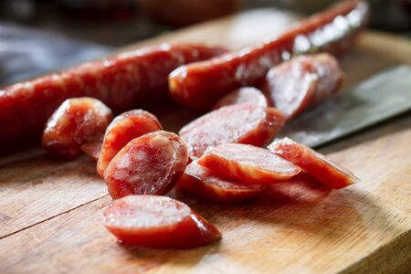 chinese meal: sliced chinese sausage sliced for cook put on cutting board