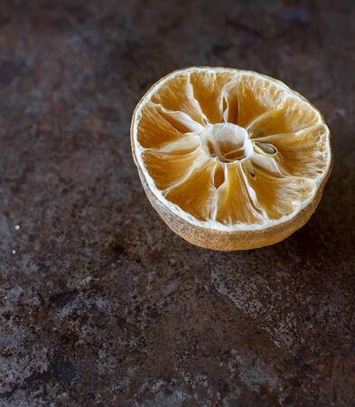 lamentable: halved dry lemon put on old metal grunge tray