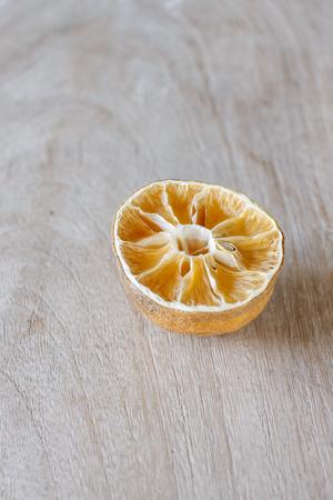 lamentable: halved dry lemon put on old white wood background Stock Photo