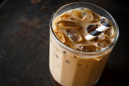 latte: Glass of Cold Iced Coffee put on grunge table Stock Photo