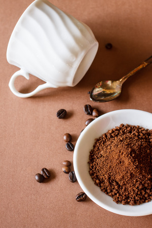 small plate: Coffee in white small plate with cup of coffee put on brown paper background , texture and text Stock Photo