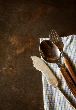 grunge flatware: Vintage silverware on rustic grunge tray