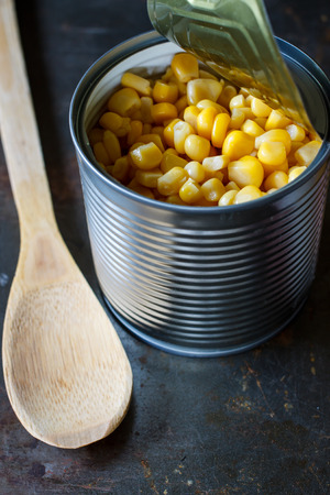 tinned goods: Sweet corn in a can, close up , put on grunge metal tray