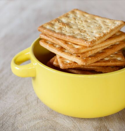 salty: Cracker put on old wood with yellow cup