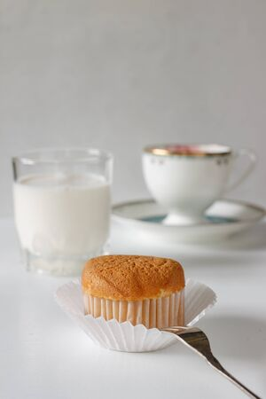 vanilla cupcake: Sweet vanilla cupcake put on vintage white background served with coffee time or tea time