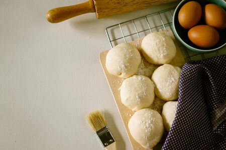 leavening: Yeast dough of homemade bread or pizza on wooden board