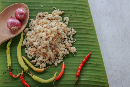 laotian: subterranean ant egg put on banana leaf with herb ingredient for cook Esan food, Lao food (local food) Stock Photo