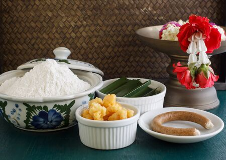 thai dessert: Ingredient for Thai dessert. flour, palm sugar, pandan leaf, candle used for smoking sweetmeats. object put on green wooden background.