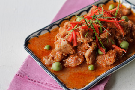 thai culture: Local authentic cuisine of Thailan: Dried red pork coconut curry (Panaeng in Thai name.) : Delicious and famous Thailand food. Asian cuisine pork curry. Stock Photo