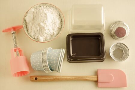 being the case: Various tins and paper cases for tartlets and muffins. image vintage tone. Stock Photo