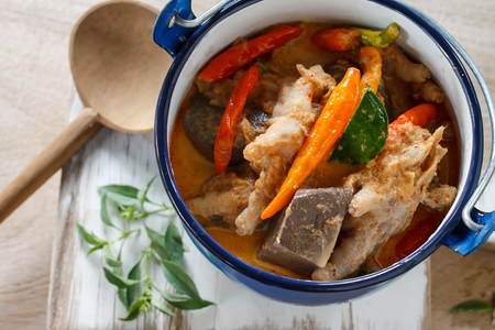 sesame street: Thai fod: chicken curry served in blue old pot. Stock Photo
