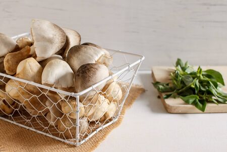 hoary: straw mushroom in white basket and hoary basil ingredient for cooking.