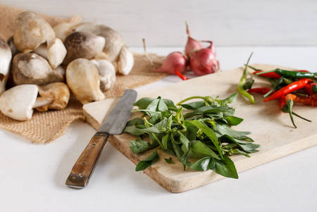hoary: straw mushroom in white basket , red shallot, chili and hoary basil ingredient for cooking.