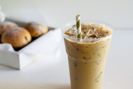 glass of cold coffee and sweet buns. Stock Photo