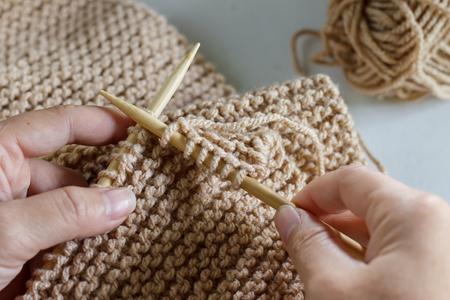 Vintage Knitting needles and yarn on white wooden background Stock Photo