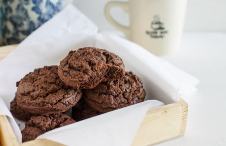 homemade delicious chocolate cookies with cup of coffee.