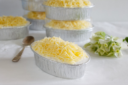cheddar cheese with fresh cream cake in mini foil.
