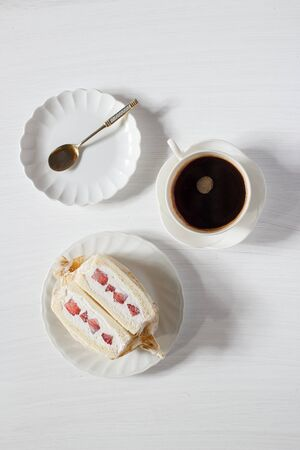 japanese fruit sandwich, fruit sando  with hot espresso coffee. Stock Photo