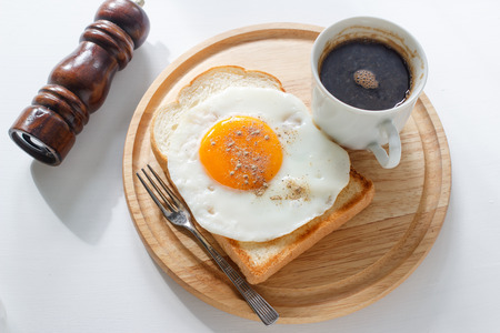 fried egg on toast, coffee on white background