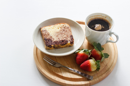 homemade marble chocolate pound cake with fresh strawberry and black coffee. minimal style.