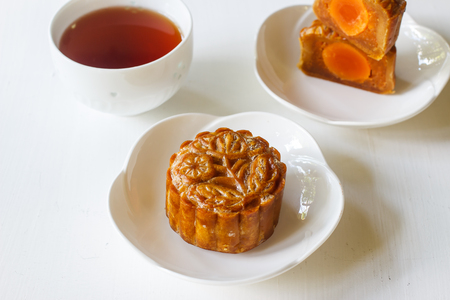 Moon cake for Mid autumn festival with cup of tea. Chinese traditional food and dessert. ( Moon cake is call