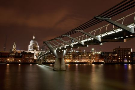View of St. Pauls Cathedral and the London Millennium Bridge from across the Thames