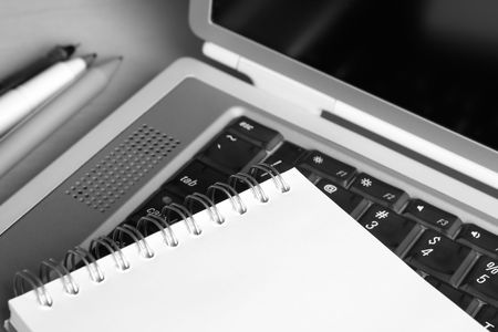 Photo of a notebook on a laptop keyboard. Shallow depth of field. Stock Photo - 3239631