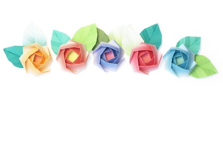 5 origami roses decoration on a white background