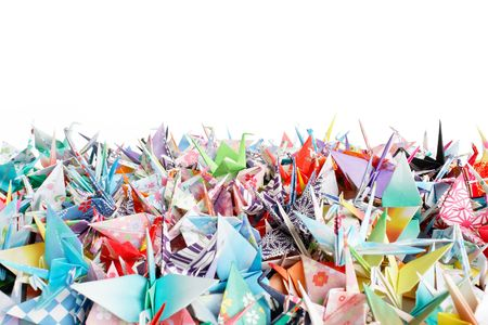 Close up of a pile of origami birds on a white background Stock Photo