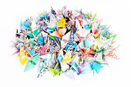 A pile of paper cranes isolated on a white background