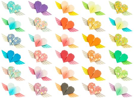 30 colorful winged-hearts isolated on a white background