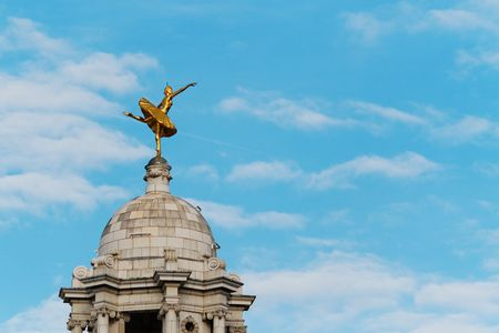 A gilded statue of ballerina Anna Pavlova above the cupola of the Victoria Palace Theatre, London Stock Photo
