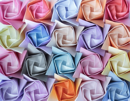 Top view of twenty colourful paper roses arranged as a decorative background  Stock Photo
