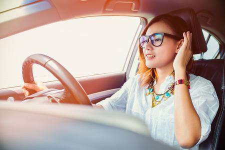 Asian woman driving a happy mood. Banco de Imagens