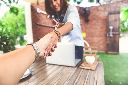 business woman working: Photos of Asian women who are shaking hands,Focus on hand Stock Photo