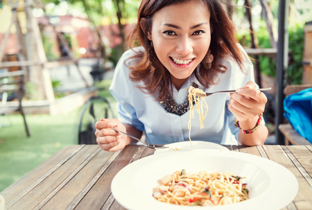 Asian women eating delicious,Focus on face Stock Photo