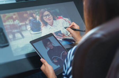 wacom: Photo of asia women are using electronic tools,focus button on hand