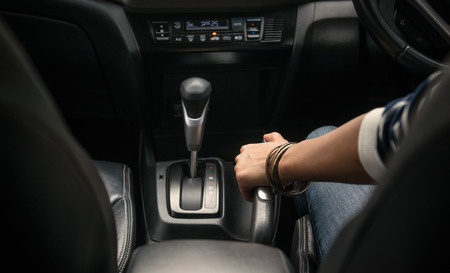 Image of pulling the handbrake on the car,focuson hand