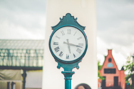 seconds: Pictures of a clock placed outdoors,Focus on the clock Stock Photo