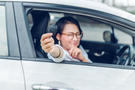 Asian women are very happy. After she got the car Focus on the keys.