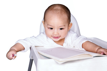 An Asian baby boy holding a pencil to write his book. Happy mood.focus on face Stock fotó - 111066469