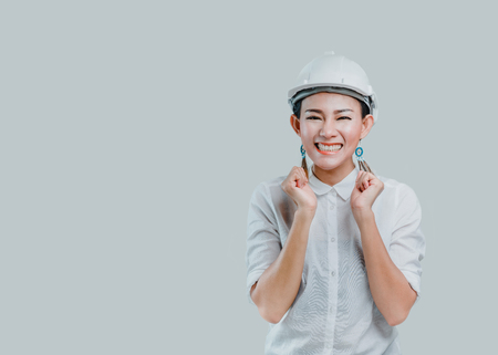 Asian women wear a helmet and have a smiling face in the studio.Focus on face Banco de Imagens