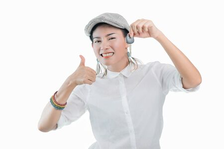 Pictures of Asian women are happy and smiling when holding the car keys. On  white background, Focus on the face.