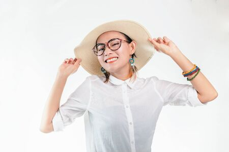 Picture of an Asian woman in a smiling and happy mood on a white background.Focus on face Banco de Imagens