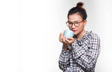 Asian woman holding a blue hot cup On a blue background,vintage style .Focus on face