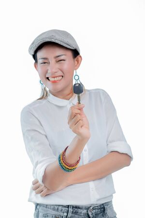 Pictures of Asian women are happy and smiling when holding the car keys.
