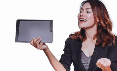 The happy face of an Asian woman when she holds her tablet.